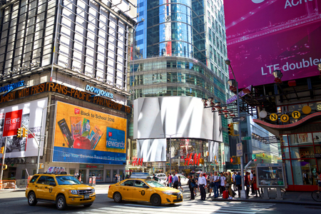 42nd: New York, New York, USA - September 14, 2016: Busy intersection at 42nd St., 7th Avenue and Broadway near Times Square with pedestrians and traffic crowds in a sunny day