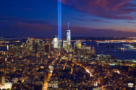 New York City Manhattan night view with light beams in memory of September 11