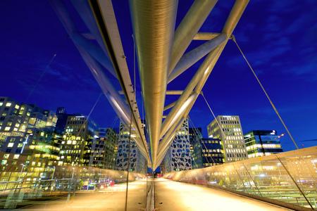 oslo: Akrobaten pedestrian bridge at dusk in Oslo, Norway