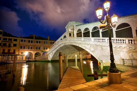Rialto Bridge (Ponte Di Rialto) at dusk in Venice, Italy