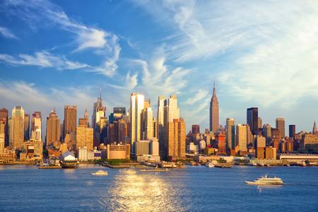 Midtown Manhattan skyline before sunset over Hudson River, New York
