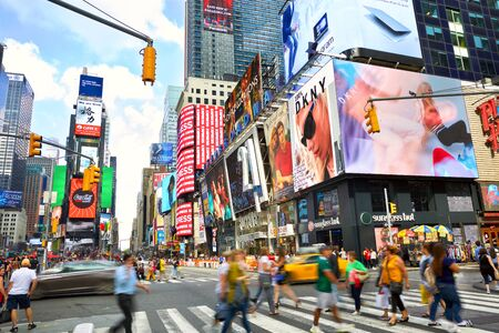 NEW YORK CITY, NY, USA - SEPTEMBER 15, 2018: Times Square crowds and traffic with lots of animated LED billboard advertising Editöryel