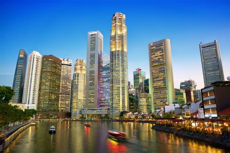 Singapore downtown skyline with river at dusk Stok Fotoğraf