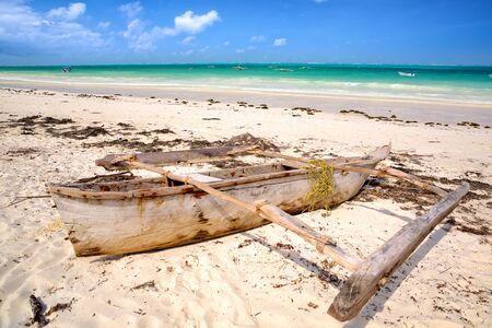 Tropical white beach with traditional dhow boat in Zanzibar Stok Fotoğraf