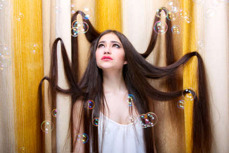 Beautiful long-haired girl and soap bubbles Stok Fotoğraf