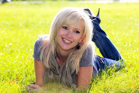 Portrait of beautiful  woman lying on green grass Stok Fotoğraf