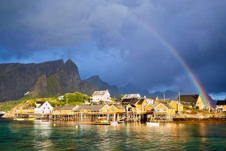 Rainbow over Reine fishing village in Lofoten Islands, Norway