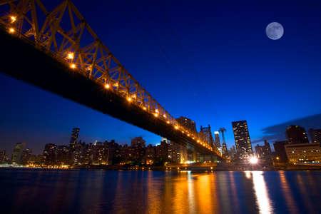 Sunset view of Manhattan skyline with Queensboro Bridge over East River