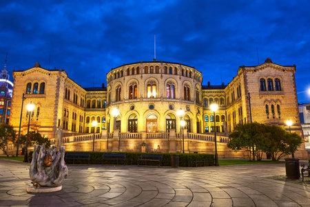 Historic building of Norwegian Parliament at dusk
