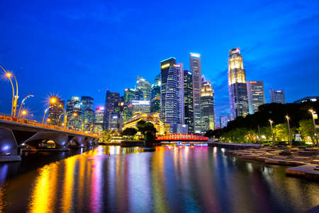 The Downtown Core of Singapore with Anderson Bridge at dusk