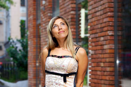 Portrait of attractive blond woman looking up