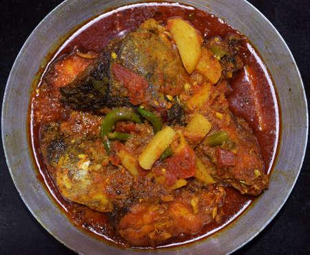 Top shot of traditional Indian bengali rohu fish dish (labeo rohita)