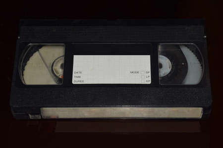 Vintage Video Cassette or Tape isolated on a dark background