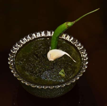 Fresh Green Coriander Paste also called as Dhaniye ki chutney in Hindi Language Stock Photo