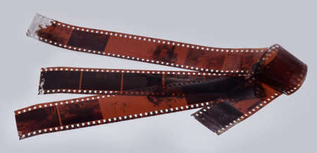 Photographic film strips or reel isolated in light grey background. Camera film Roll or Negative Banque d'images