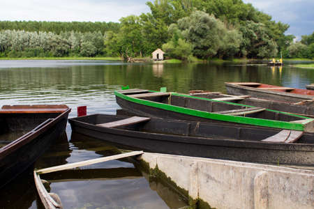Wooden fishing boats at the Danube river, Serbia Stock fotó