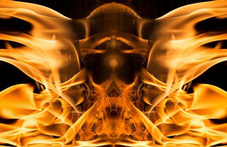Burning fire in shape of skull on black background.