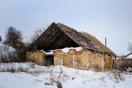The collapsed old house in winter photo
