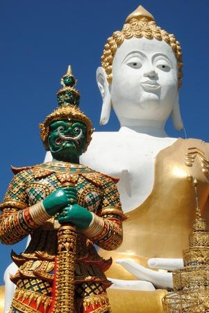 raavana: statue of buddha and revana Stock Photo