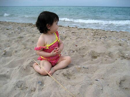 Cute little girl near the sea photo