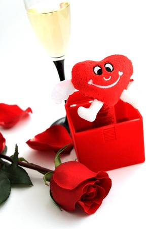 Romantic red rose with heart Valentines and glass of wine photo