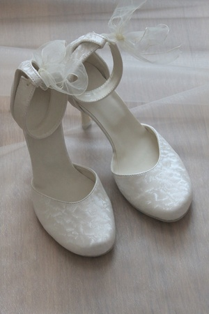 Elegant wedding shoes of the bride photo