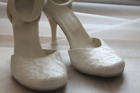 Wedding shoes of the bride photo