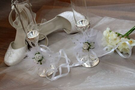 Elegant wedding shoes, wedding glasses and freesia  photo