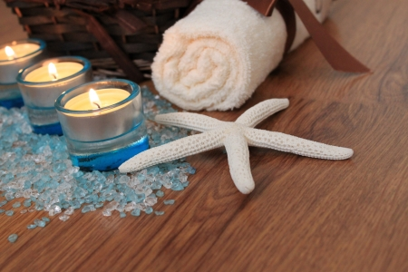 Spa   Wellness composition with blue candles, bath salt and starfish photo