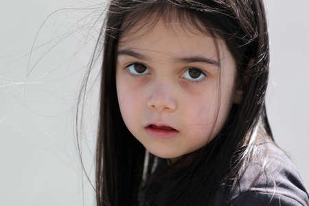 absorbed: Sad little girl standing alone Stock Photo