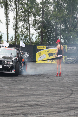 high torque: Drifting car and girl Editorial