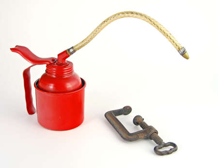 Old Red Oil Can and C-Clamp photo