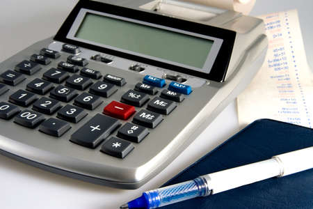 Calculator and Tape of Figures and Pen for Checks Stock Photo