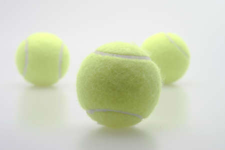 pressurized: The three amigos tennis balls following the leader Stock Photo