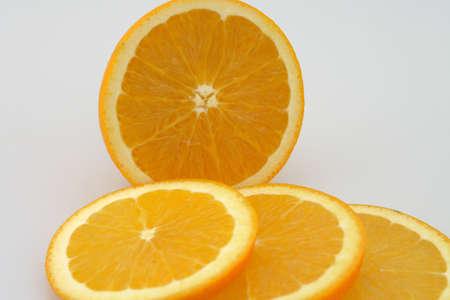 Fresh Oranges Sliced ready to eat Isolated Stock Photo - 2482035