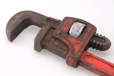 Old Vintage red handled plumbers pipe wrench photo