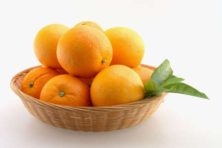 Fresh Oranges stacked in a basket and Isolated  Stock Photo - 2503591
