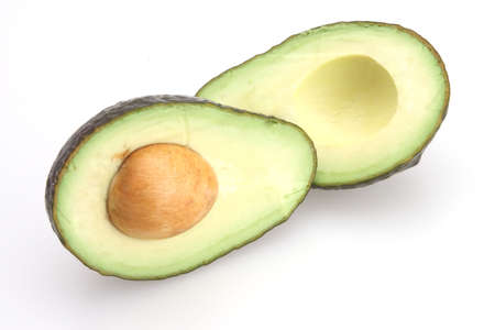 Avocado sliced in half with seed in center Stock Photo - 2585231