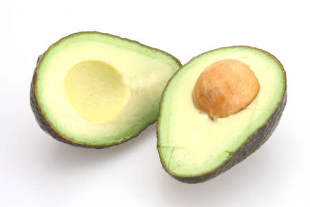 Avocado sliced in half with seed in center Stock Photo - 2585244