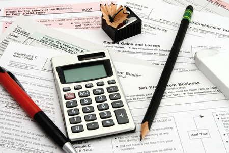 Calculator tax forms pen pencil eraser sharpener