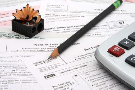 Calculator tax forms sharp pencil and sharpener  Stock Photo