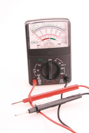 Volt meter red and black leads plugged in