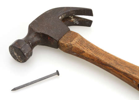 Old vintage hammer and nail for home construction photo