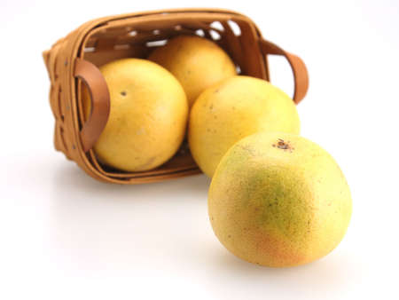 Fresh Oranges rolling out of wicker basket Stock Photo - 2702143