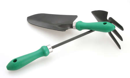 Gardening tools trowel and cultivator for planting and weeding white background