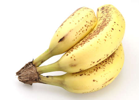 overly: Bunch of bananas that are getting overly ripe Stock Photo