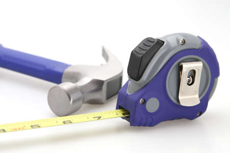 Hammer and tape measure focus on tape and hammer  Stock Photo