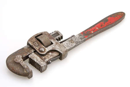grasping: Old Vintage red handled plumbers pipe wrench