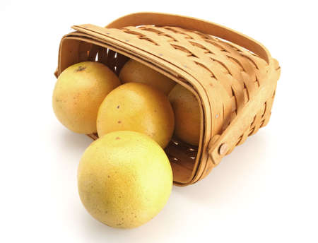 Fresh Oranges rolling out of basket made of wicker  photo