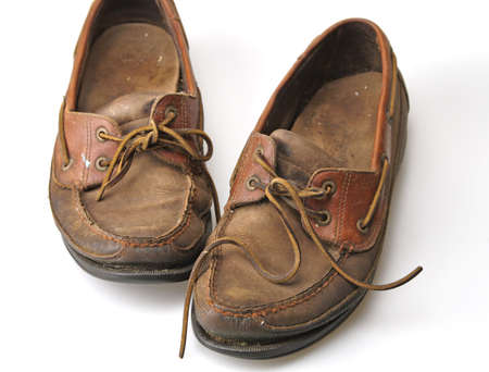 travelled: Old pair of worn out boating deck shoes Stock Photo